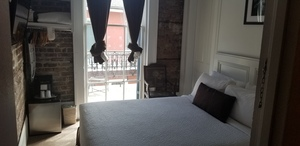 Petite Queen Bedroom with Bourbon St Balcony Photo 1