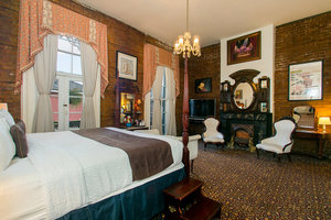 King Bedroom with Bourbon St. Balcony Photo 1