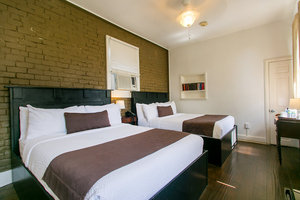 Double Queen Bedroom with a Shared Courtyard Balcony Picture 1